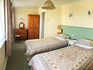 The twin bedroom, downstairs at Treliza apartment, Garden Cottage Holiday Flats