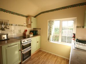 The kitchen in Trevose View apartment, at Garden Cottage Flats.